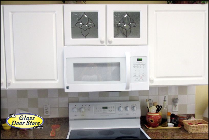 Cabinet Glass Installed In White Kitchen Cabinets Above The Stove And  Microwave
