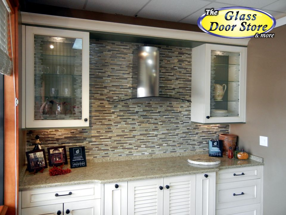 Etched cabinet glass that matches the tile backsplash ...