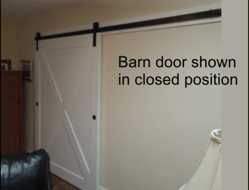 Barn doors cover a wide opening in this Tampa home