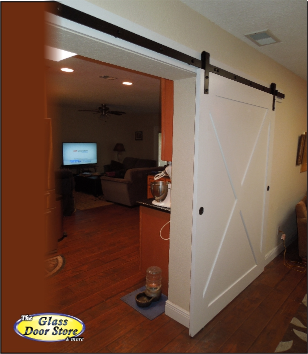 barn doors cover a wide opening in this tampa home With barn door wide opening