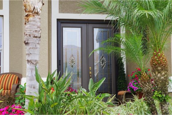 Double doors with decorative glass door inserts in Tampa home