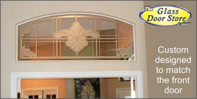 Etched glass transom window above french doors