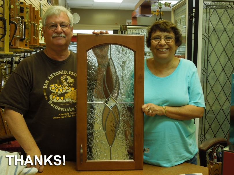 The Landress family picking up the cabinet glass