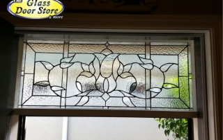 Stained glass transom window above the front door