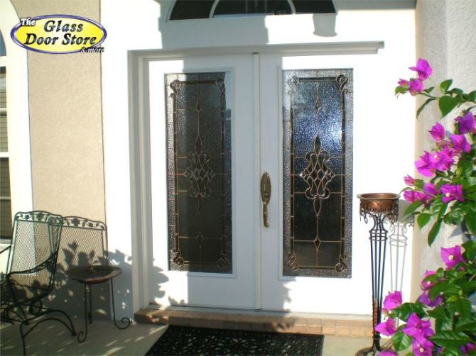 Antique brass glass doors in double white front doors