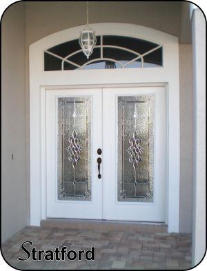 white double fiberglass front entry doors with glass door inserts in silver