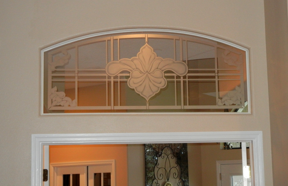 Etched glass transom above french doors