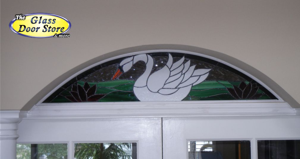 A stained glass transom over the interior french doors