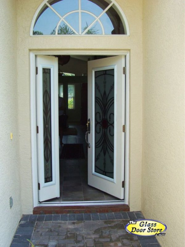active sidelight ith single wrought iron front door